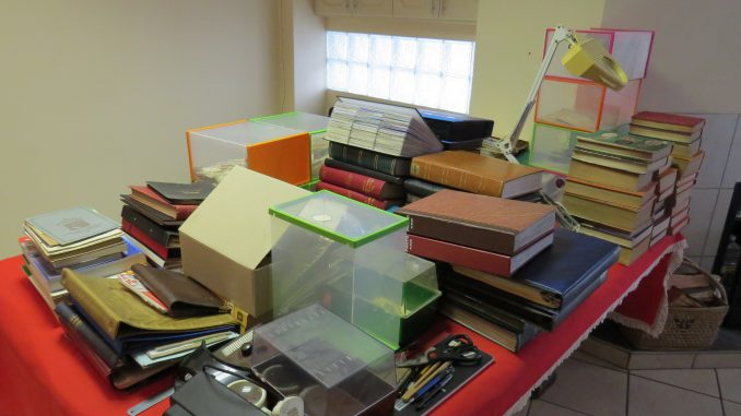 An Image of a 2.5m x 2m table loaded with stamp Albums